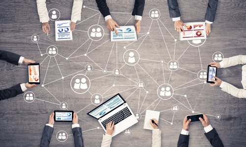 Group,Of,People,With,Devices,In,Hands,Working,Together,As